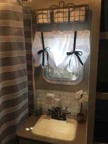Faux peel and stick subway tile backsplash in RV bathroom by Jennifer Reid