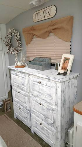 Distressed painted wood in farmhouse style RV bedroom makeover by Michelle Sharp