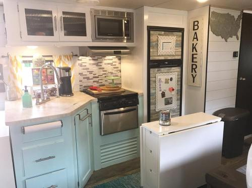 RV kitchen with Farmhouse style decor by Amy Smith