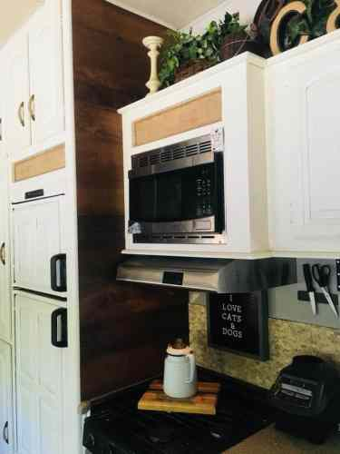 Peel and stick flooring used to make a wood plank wall. Burlap added to inset cabinet panels.
