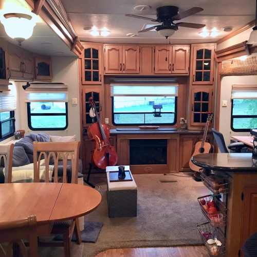 Our RV with my cello and Josiah's guitar