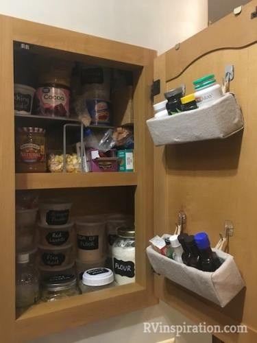 Plastic #storage containers and DIY baskets hung from cabinet doors with Command hooks help me organize my #RV pantry cabinet.