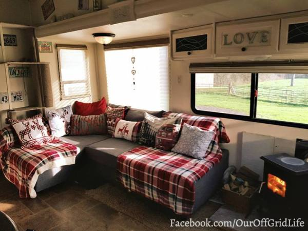Ikea sofa bed sectional and wood stove in RV   facebook.com/ouroffgridlife