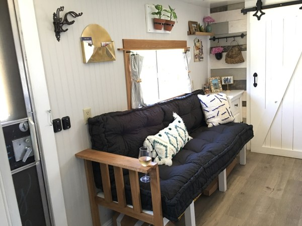 DIY wood RV sofa bed in toy hauler by John and Robyn Crowhurst of Instagram.com/TinyHouseTaylor