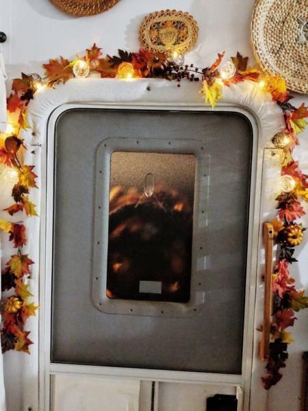 Fall garland around RV door frame by Krista Schmidt
