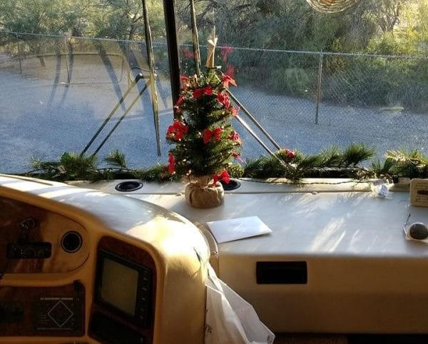 Tiny Christmas tree on motorhome dashboard