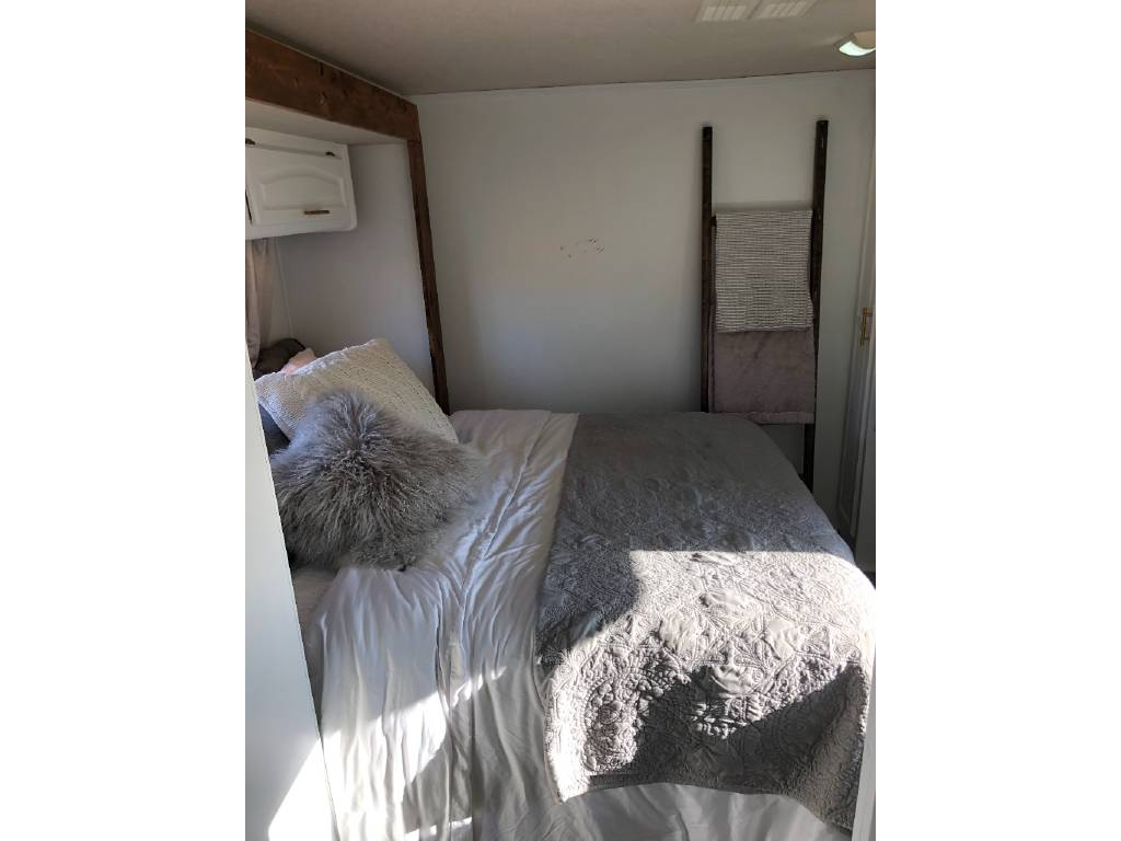 Bedroom in renovated camper motorhome