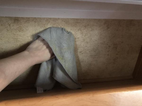 Cleaning RV closet walls to prepare for installation of fake shiplap wall panels