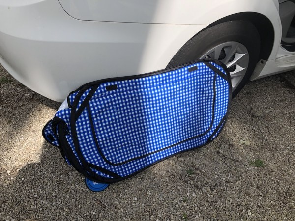 Collapsible cat carrier flattened