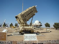 A Patriot missile battery is displayed at the missile range museum.