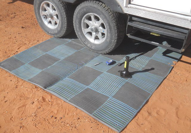 Spread Out Your Patio Mat In Front Of The Tire/wheel Assembly Needing  Attention, And Then Drive The RV Onto The Mat, Leaving Enough Room For You  To Kneel ...