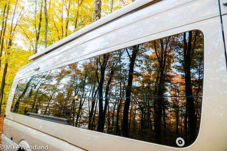 The autumn splendor reflected in the window of our Roadtrek