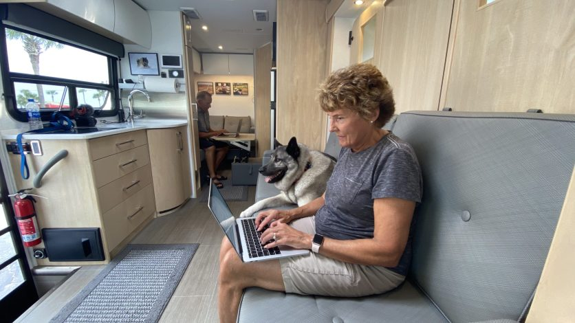 """Newbie RV Advice - Jennifer's """"office"""" in the RV. Mike can be seen in his area in the back."""