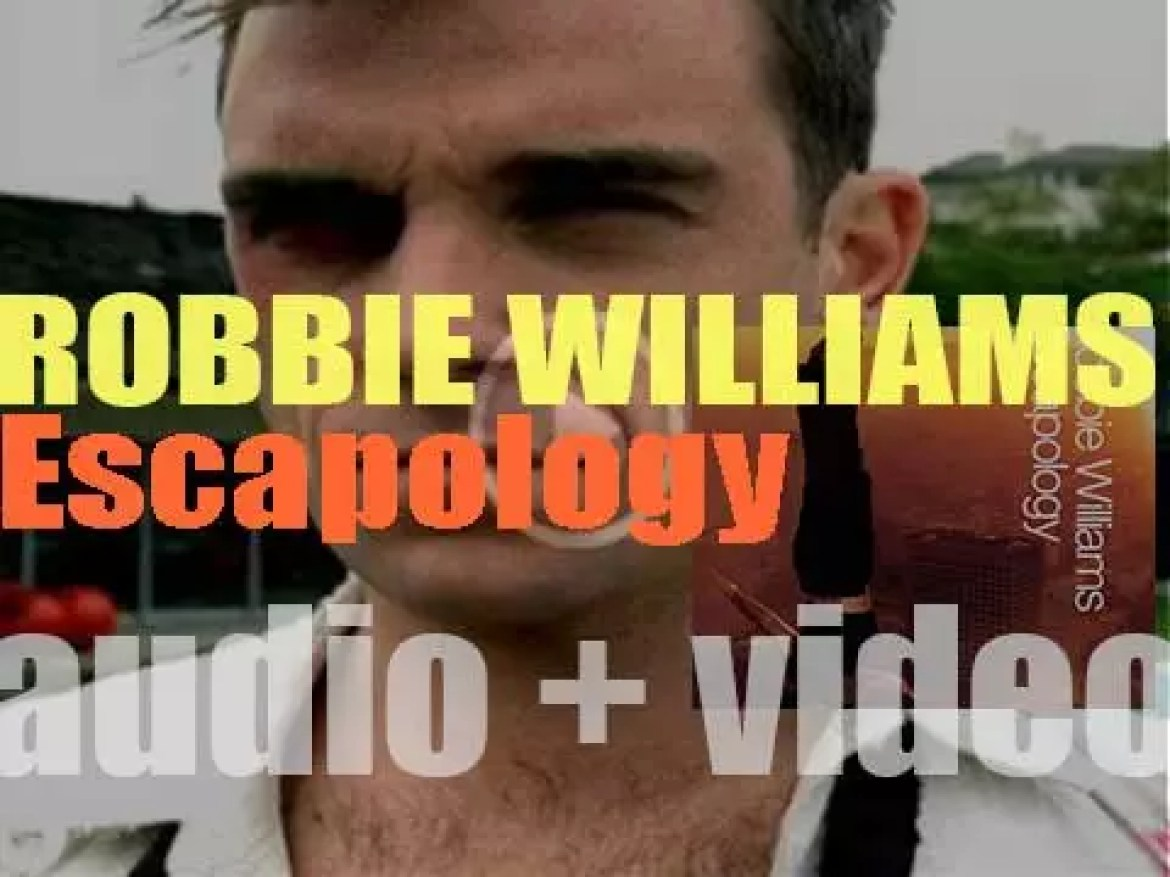Robbie Williams releases his fifth album : 'Escapology' featuring 'Feel' and 'Come Undone' (2002)