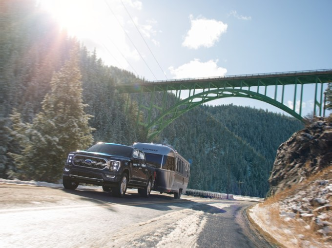 The 2021 F-150 pulling an Airstream. The F-150 is the best selling car in America.