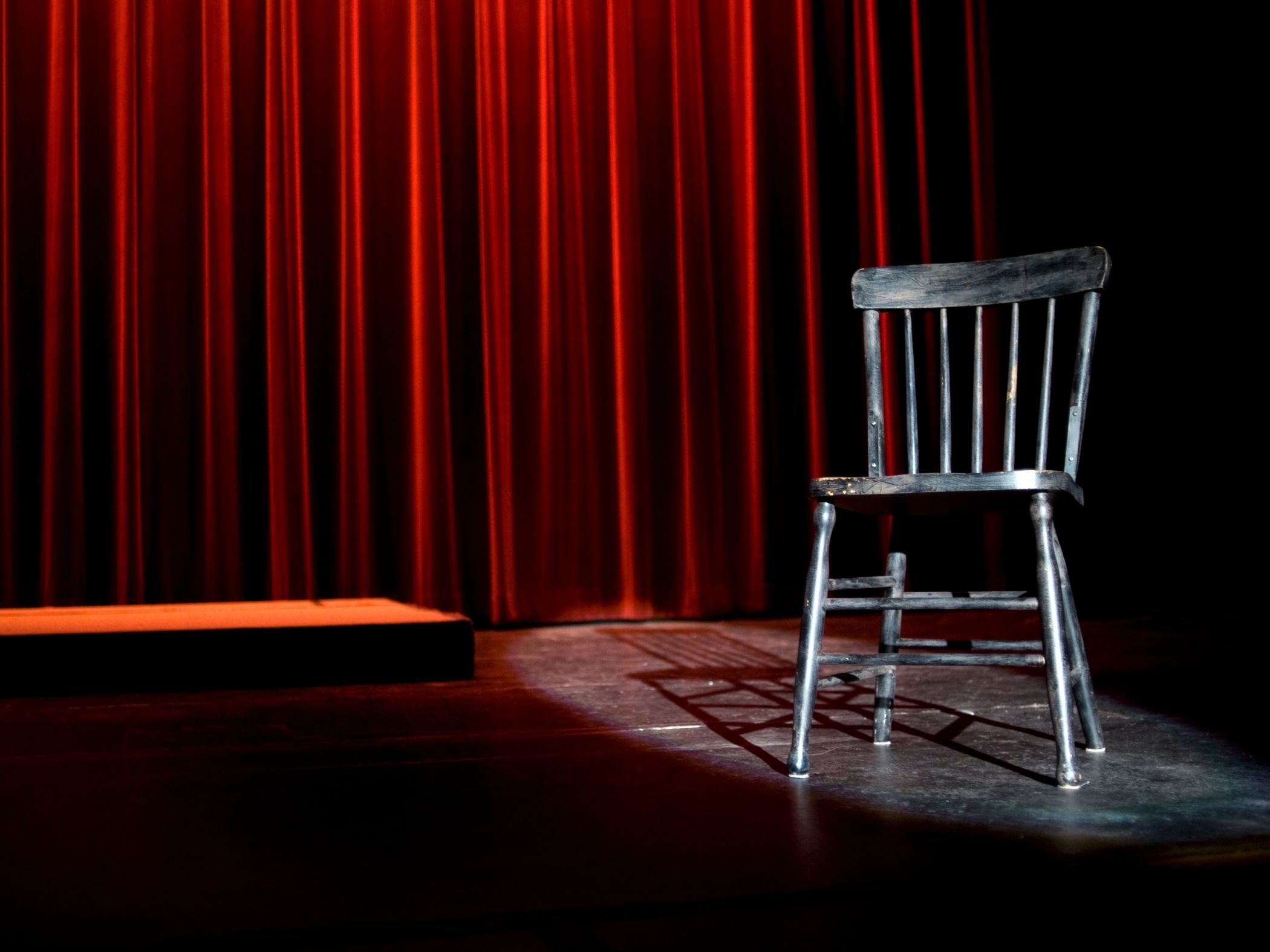 Photo of empty chair on a stage