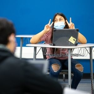 Student giving peace signs.