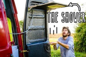 Small RV Trailers Bathroom - A shower with a rain shower head built into the rear door of a van. How awesome is that?!
