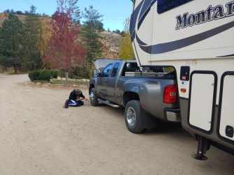Craig inflating truck tires on the side of the road with our RV tire inflator