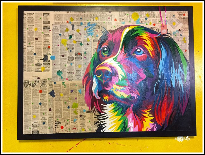 A Painting of Dog Over Newspaper