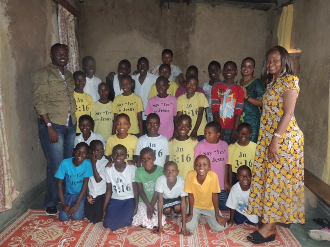 RCEF Director Jeanine Mukarubega with students