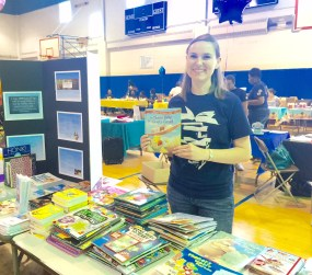 Sarah Casnovsky poses with some of the amazing books we distributed.