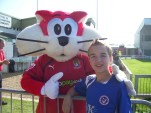 with Morecambe's mascot