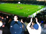 The away fans clap the players after a good win