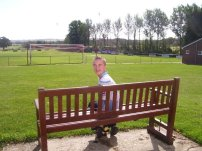 Sat on a bench behind the goal!