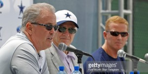 "The Dallas Cowboys' Stephen Jones, left, executive vice president, COO, director of player personnel, joins Jerry Jones, owner, president, general manager, and head coach Jason Garrett, right, during the team's annual ""state of the Cowboys"" news conference at training camp in Oxnard, Calif., on Wednesday, July 29, 2015. (Paul Moseley/Fort Worth Star-Telegram/TNS)"