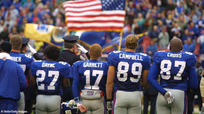 Dan Campbell stands next to then teammate and future Dallas Cowboys head coach Jason Garrett during the national anthem before a game against Kansas City in 2001. It was the Giants' first game since the World Trade Center happenings of 9/11.