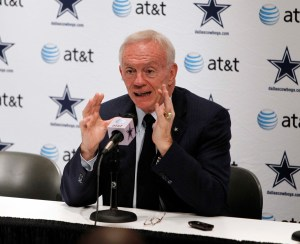 Dallas Cowboys owner Jerry Jones talks with reporters