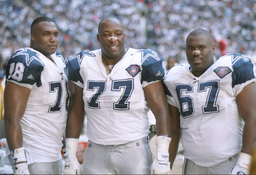 Russell Maryland (67) stands on the sideline with Jim Jeffcoat (77) and Leon Lett during a 1994 Divisional playoff game at Texas Stadium versus Green Bay.