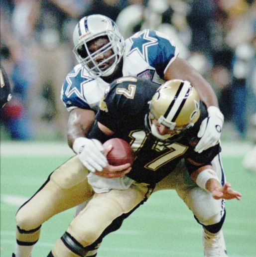 Russell Maryland takes down New Orleans QB Jim Everett for a sack during a game in December of 1994. The Cowboys won 24-16.