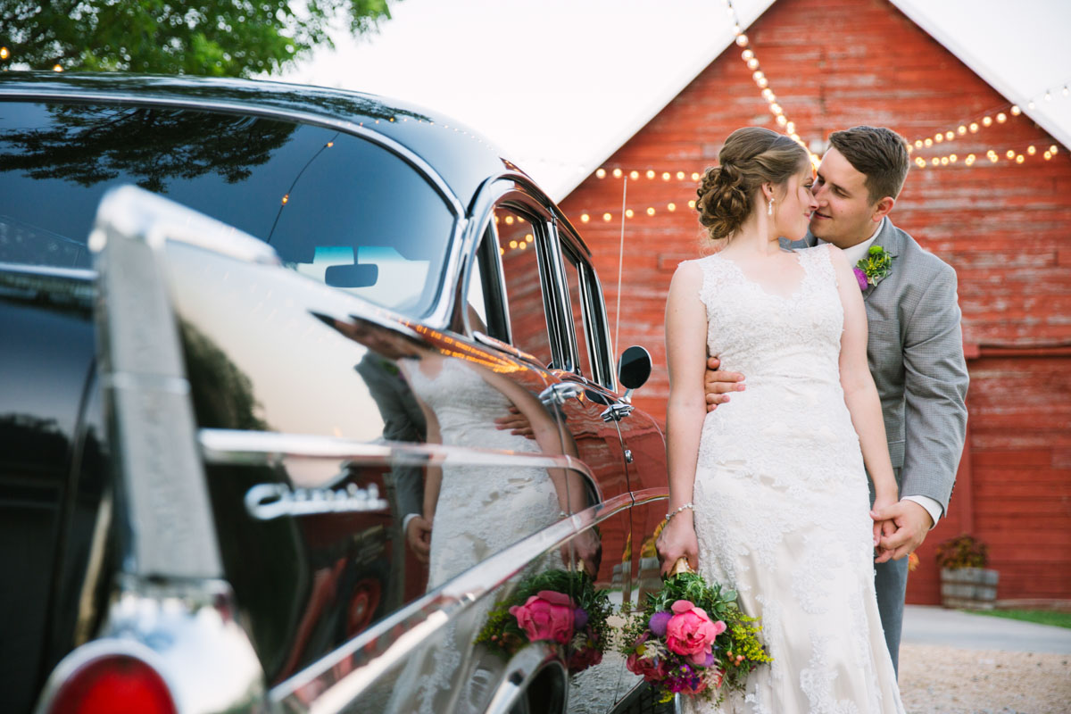 Rustic Grace wedding with vintage car and red barn