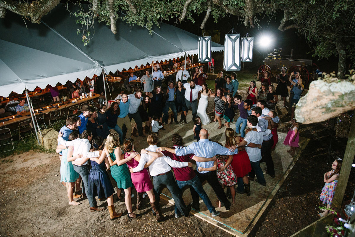 aggie war hymn at aggie wedding captured by wedding photographer in tree