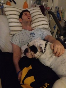 Duke cuddles with Ryan.