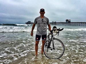 Frank takes a moment to step into the Pacific Ocean before riding 3,000 miles across country.