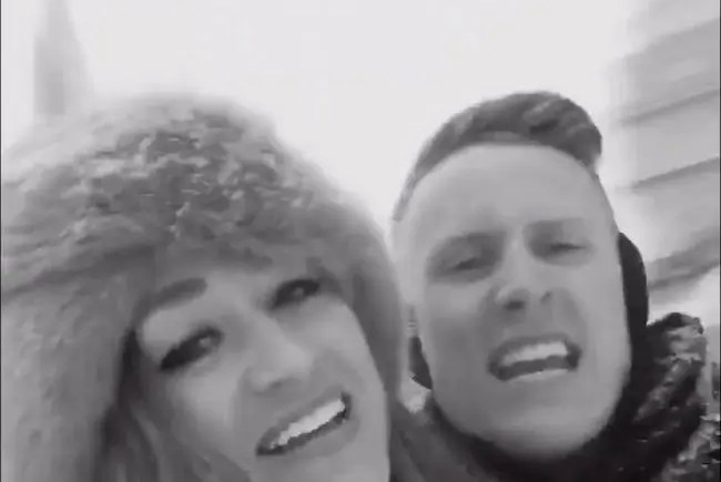 "Screenshot of Bridget Groves and Everett Warren in their ""epic snowstorm video"" lip-syncing Adele's ""Hello."""