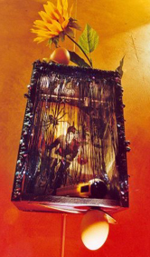 APACHE, SUR UN VELO, ALLANT AU MONDE DES OEUFS: Collaged lamp box with hollowed egg frame and curtains, $700