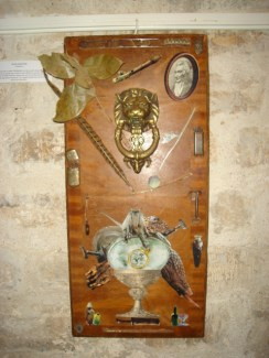 PANDORA: Antique armoir cabinet door with sunken ship collage and antique lion knocker, $800