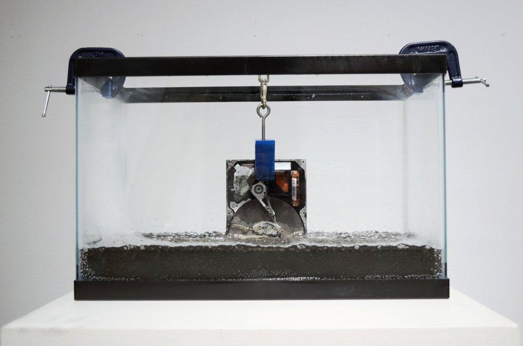 Eyewash: Acid Bath_ 12x16x12_hardrive, hydrocholoric acid, 3d-printed components, hardware