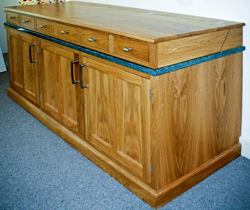A bespoke kitchen unit designed to disguise the sink unit and draining board.