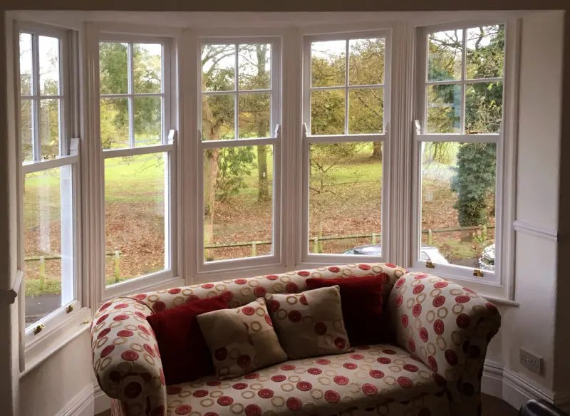 An image of a large bay window containing five separate sash windows. The sashes have been double glazed and fully upgraded,