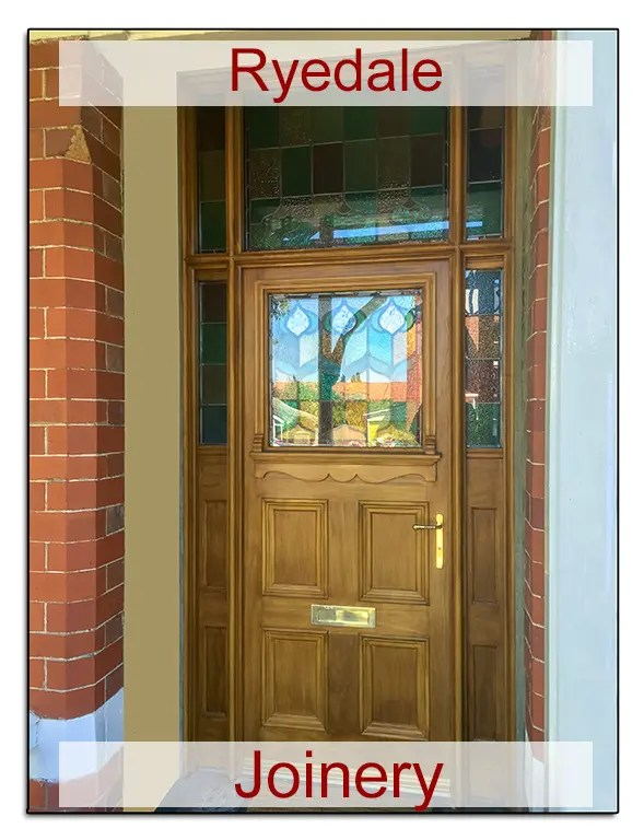 Exterior door and frame with stained glass panels.