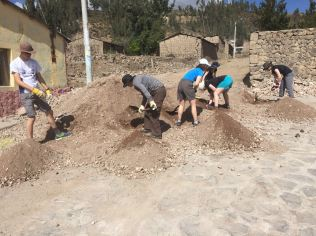 Work at Pinchollo sorting dirt to make concrete for the foundations of a new dining room for the local school