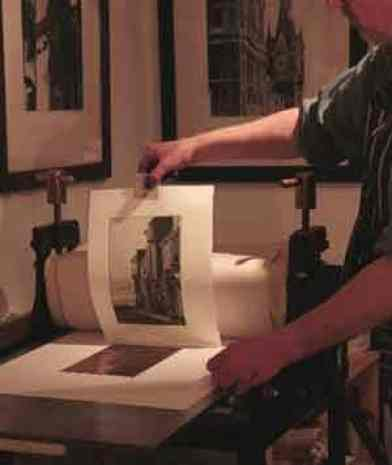 Print being pulled off plate after passing through press.