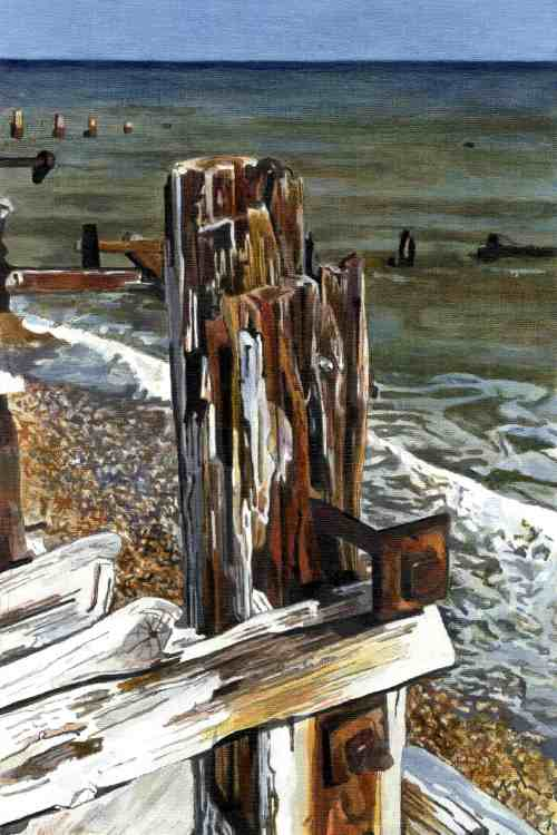 FIRST WAVE The tide comes in on Winchelsea beach. The end of a battered and weary groyne with protruding bolt awaits the inevitable.