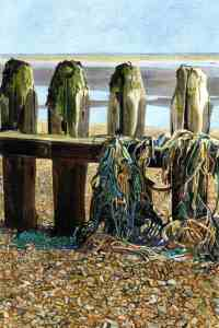 FOUR POSTER Four groynes stand festooned with washed up fishing nets and rope on the beach near Rye Harbour.