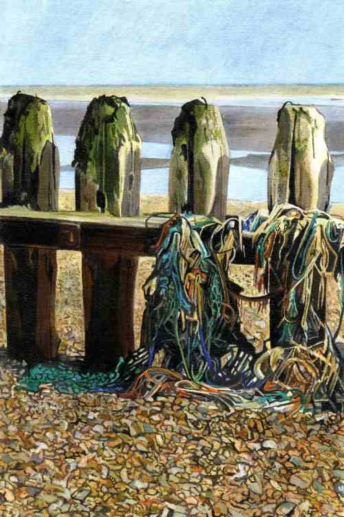 FOUR POSTER Four groynes stand festooned with washed up fishing nets, rope, and seaweed on the shingle beach near Rye Harbour.